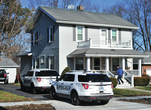 Mike Ullery | Troy Daily News Troy police work at the scene of an apparent robbery on McKaig Ave on Friday