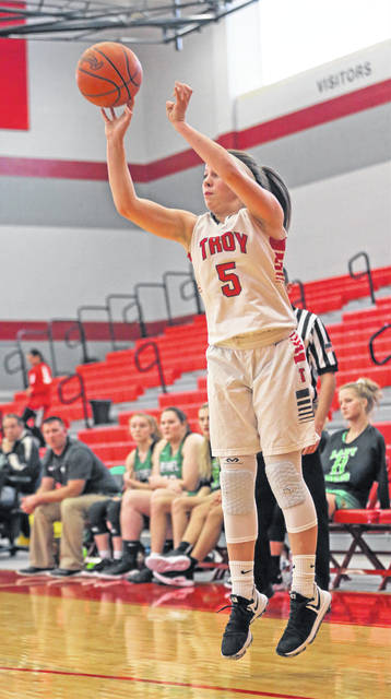 Lee Woolery|Miami Valley Today file Troy's Macie Taylor hits a 3-pointer against Bethel this season.