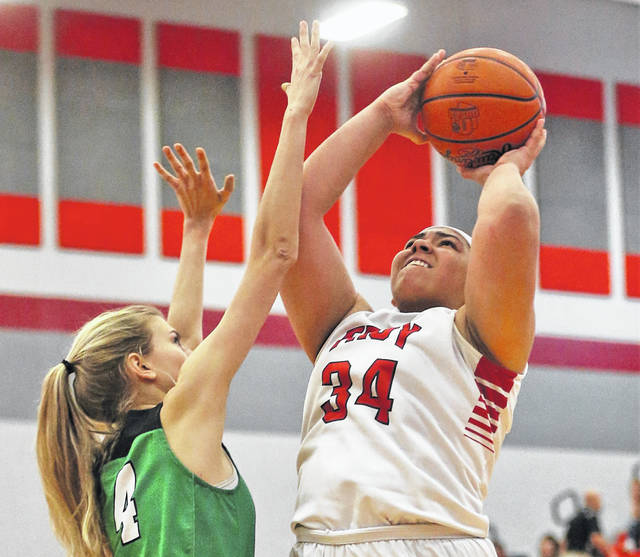 Lee Woolery|Miami Valley Sunday News Troy's Tia Bass goes up for two points in the Trojans' home opener Saturday against Bethel.
