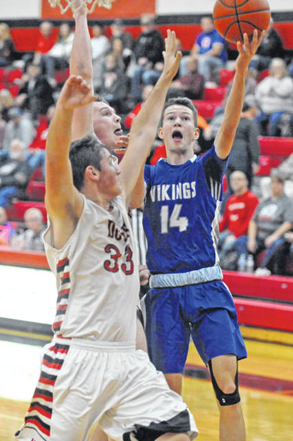 Josh Brown|Miami Valley Today Miami East's Wes Sutherly drives to the basket Saturday at Milton-Union.
