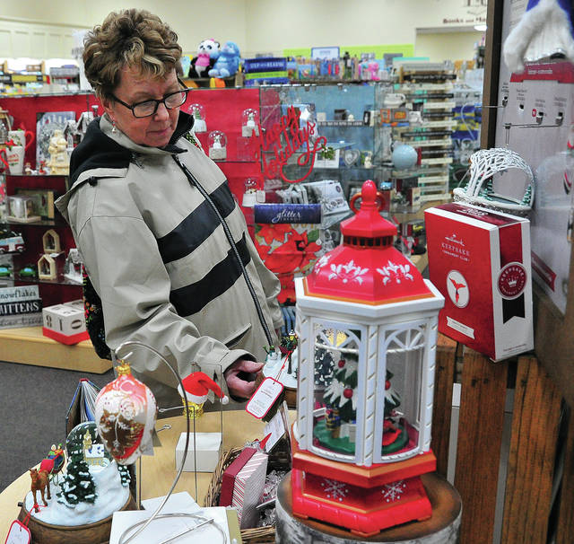 Mike Ullery | Daily Call Jane Mikolajewski of Piqua checks out the Christmas gift selection at Readmore Hallmark in Piqua on Friday. With only three days left in the 2018 Christmas shopping season, stores are packed with customers searching for the perfect last-minute gifts.