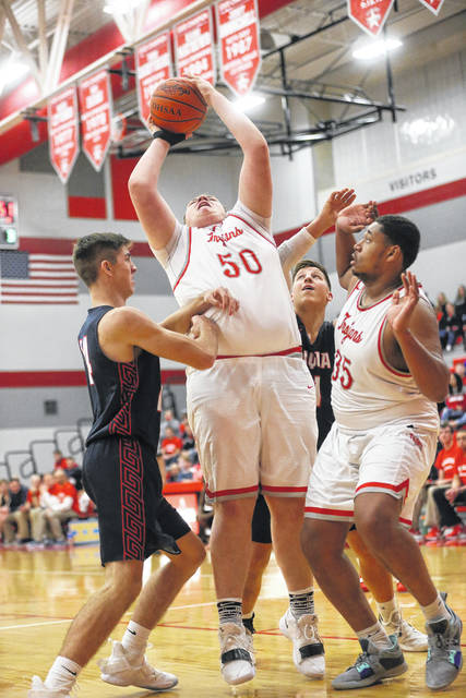 Lee Woolery|Miami Valley Sunday News Troy's Andrew Holley (50) scores a basket during the fourth quarter of Friday's victory over Piqua at the Trojan Activities Center.