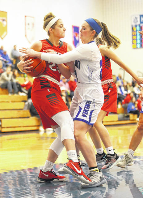 Lee Woolery|Miami Valley Sunday News Troy's Lauren McGraw and Miami East's Whitley Gross battle for the ball Saturday at Miami East High School.