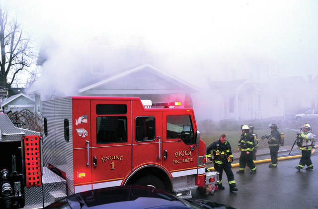 Mike Ullery | Daily Call Firefighters from Piqua, Covington, and Fletcher battle a house fire at 511 Scott Street in Piqua on Monday morning.
