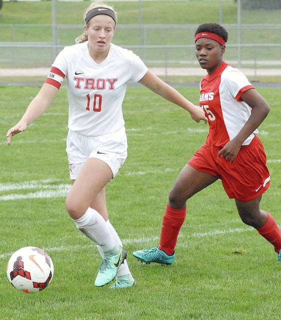 Miami Valley Today file photo Troy's Kenzie Evans (left) recently signed her national letter of intent to play soccer at Purdue University Fort Wayne.