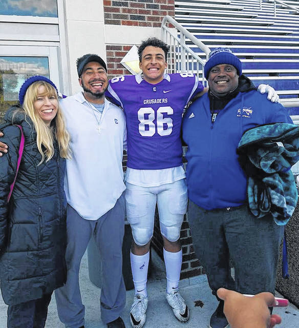 Photo Provided The Lee family shares a moment at a Capital football game this season. From the left are Peg, Kris Jr., Kameron and Kris.