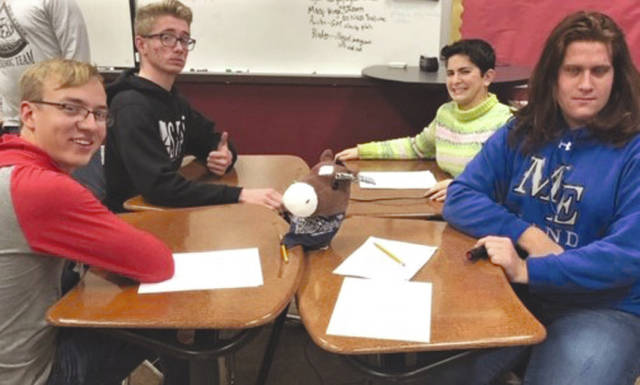 Provided photo The Miami East Academic Team improved to 9-0 in the DPM League, defeating Valley View, Eaton, and Arcanum. Scores were 83-42 (Valley View), 95-42 (Eaton), and 88-44 (Arcanum). Members include, front from left, Seth Teeters and Keagan Mahan. Back, from left, A.J. Christian and Marie Cook.