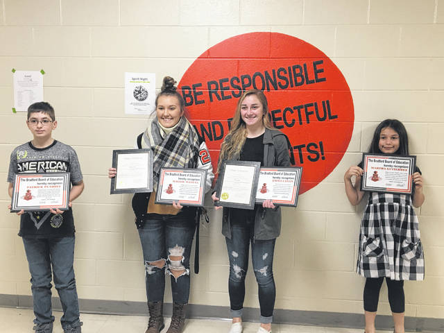 Sam Wildow | Miami Valley Today From left to right, Bradford fifth-grade student Patrick Puthoff; sophomores Maggie Manuel and Emma Canan; and third grade student Martha Gutierrez were recognized during the Bradford Board of Education meeting on Monday evening.