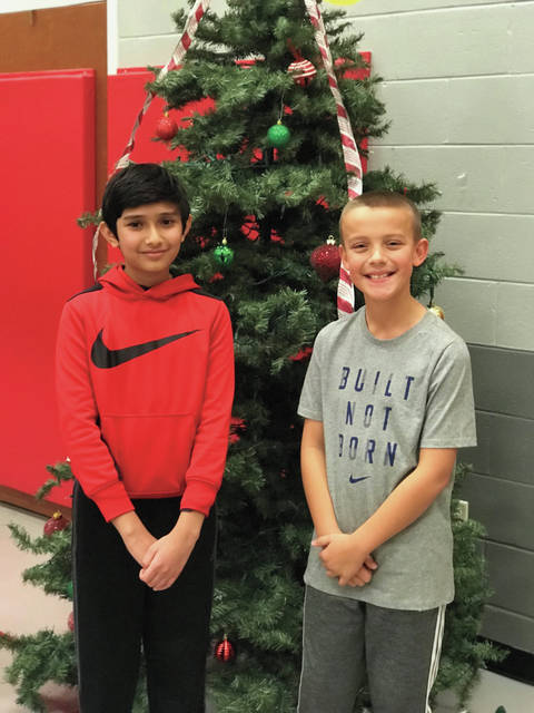 Pictured on the right, fourth grade student Max Erdahl was declared the winner of the Concord Spelling Bee. Fifth grader, Parth Rajput, was the runner up. Erdahl will represent Concord at the Troy City Schools district spelling bee in January.