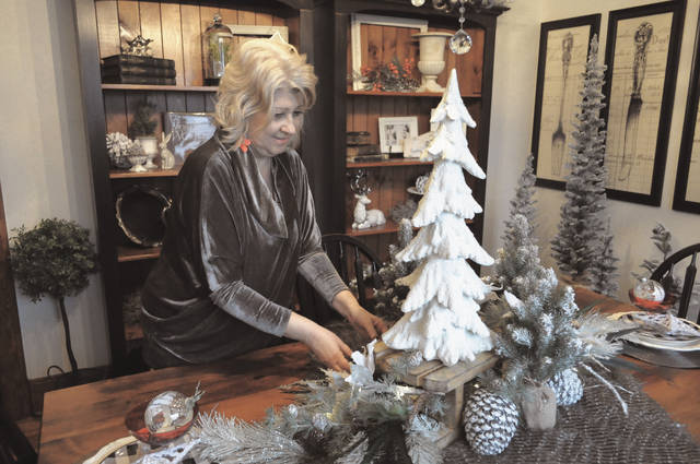 Cecilia Fox | Miami Valley Sunday News Cini Geist created a wintry design for a home on Horton Avenue that included polar bears, snowy trees and treasured family keepsakes.