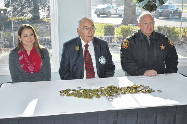 Cody Willoughby | Troy Daily News From left, Vicky Kinsley-Henry, safe communities coordinator for Miami Public Health, Troy Rotarian Larry Heisey, and Chief Deputy Steve Lord present the Designated Driver buttons now available throughout the county during the campaign kickoff on Tuesday at Troy Country Club.