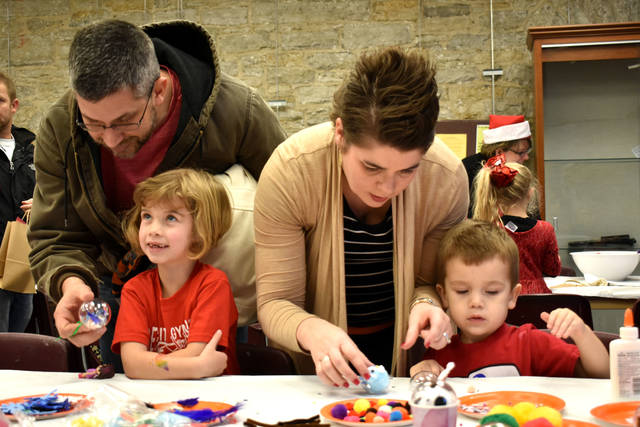 "Cody Willoughby | Troy Daily News Nathan and Jennifer Swigart of Troy craft custom ornaments with Evelyn and Oliver, 5 and 2, during ""Children's Day"" on Saturday, Dec. 1 at Troy-Hayner Cultural Center."