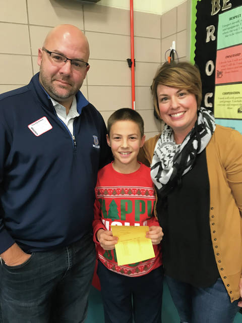 Cookson Elementary School's 2018 Spelling Bee winner is fifth grader Mitchell Sargent. Sargent is pictured with his parents Lucas and Lisa Sargent. Izabel Olivieri was the runner-up. Sargent will represent Cookson at the city of Troy Spelling Bee next month.