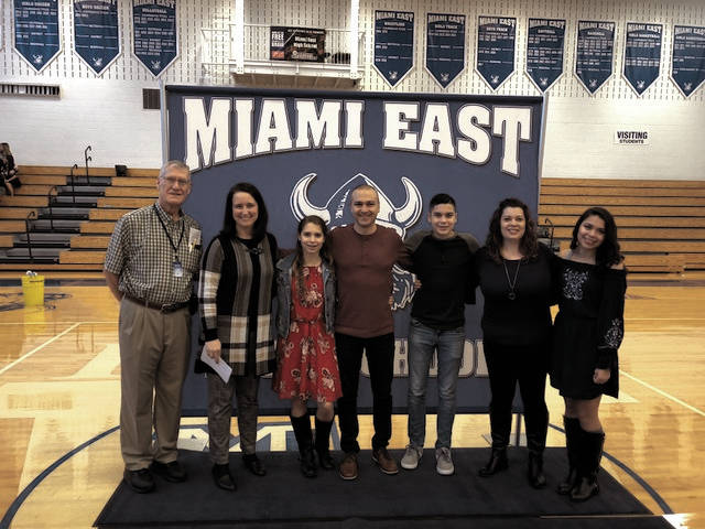 Provided photo Miami East music teacher Omar Lozano was named Ohio Music Educator's Association's Teacher of the Year on Dec. 7. Lozano is pictured with members of the OMEA and his family. Pictured from left, OMEA member Frank Fahrer, OMEA President-Elect Ann Usher, Hannah Lozano, Omar Lozano, Caleb Lozano, wife Melissa Lozano and Gabrielle Lozano.