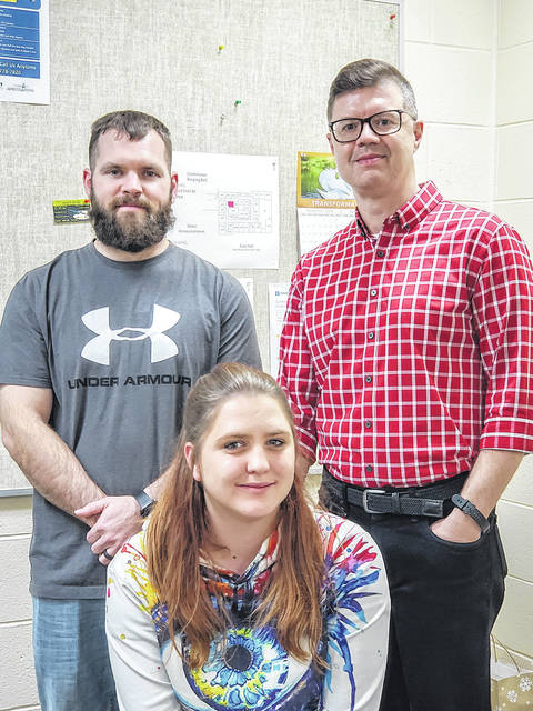 Provided photo William Loudermilk, associate professor of English at Edison State Community College, stands with winning essay writers Mitch Bolin, first place, and Heidi Bundy, third place. Not pictured is second place winner Matthew Farrier.