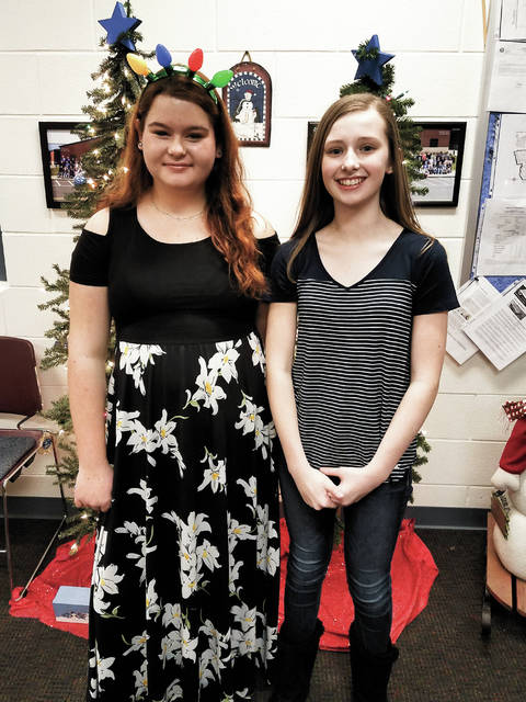 Haley Young, a seventh-grader from Fletcher, won the 2018 Miami East Junior High spelling bee. Young, right, is pictured with runner-up, eighth-grader Kierstin Thomas from Troy. Young is the daughter of Amber and Bill Young. Thomas is the daughter of Shane and Dawn Thomas.