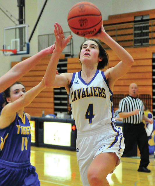 Lehman Catholic's Anna Cianciolo scores two points against Waynesfield-Goshen Thursday night at Lehman.