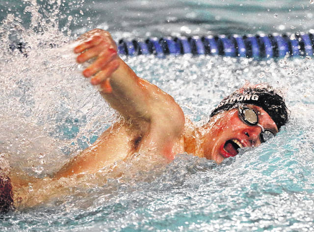 Lee Woolery|Miami Valley Sunday News Troy senior Calvin Armstrong competes in a freestyle race during a Senior Night dual against Lebanon Friday at the Robinson Branch YMCA.
