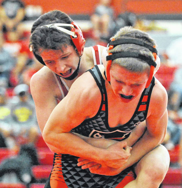 Josh Brown|Miami Valley Sunday News Milton-Union's Peyton Brown controls Coldwater's Grant Heuing during the Bulldog Invitational Saturday at Milton-Union High School.