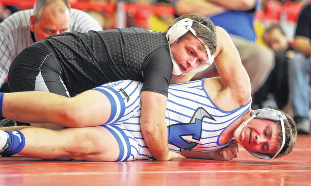 Lee Woolery | Miami Valley Today Covigton's Keringten Martin (top) ranked No. 6 in the state in his weight class in Division III, took first placed at the Troy Invitational over the weekend.