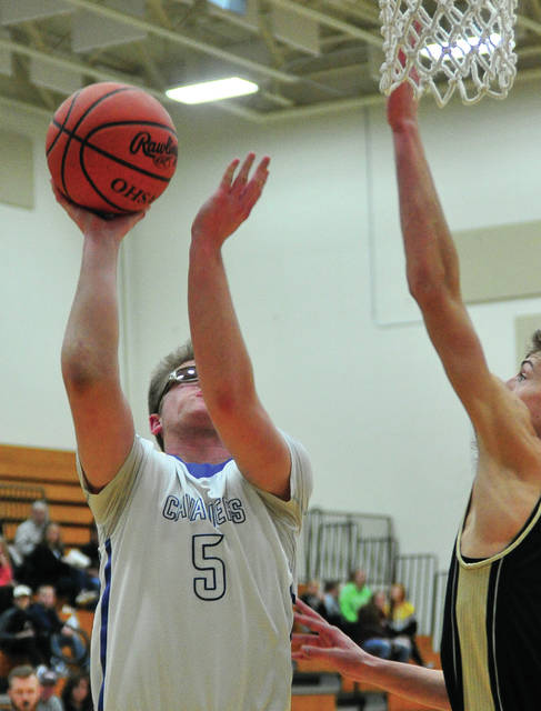 Lehman Catholic's Bryce Kennedy gets off a shot under the basket Saturday night against Parkway.