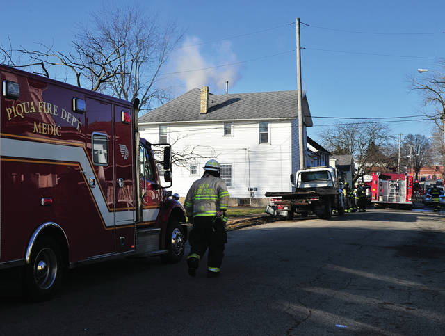 Mike Ullery | Miami Valley Today  Firefighters from Piqua and Covington battle a Saturday morning house fire on Camp Street.