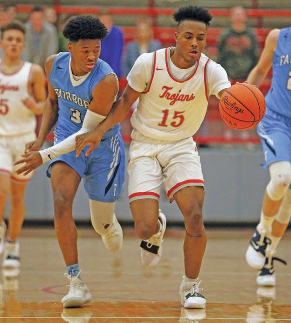 Lee Woolery|Miami Valley Today Troy's Caillou Monroe (15) races Fairborn's Shaunn Monroe (3) down the floor Tuesday night at the Trojan Activities Center.