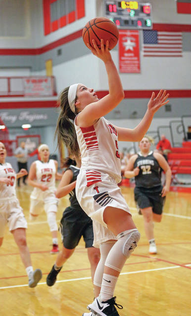 Lee Woolery|Miami Valley Today Troy's Macie Taylor lays the ball in on a fast break against Stebbins Wednesday at the Trojan Activities Center.