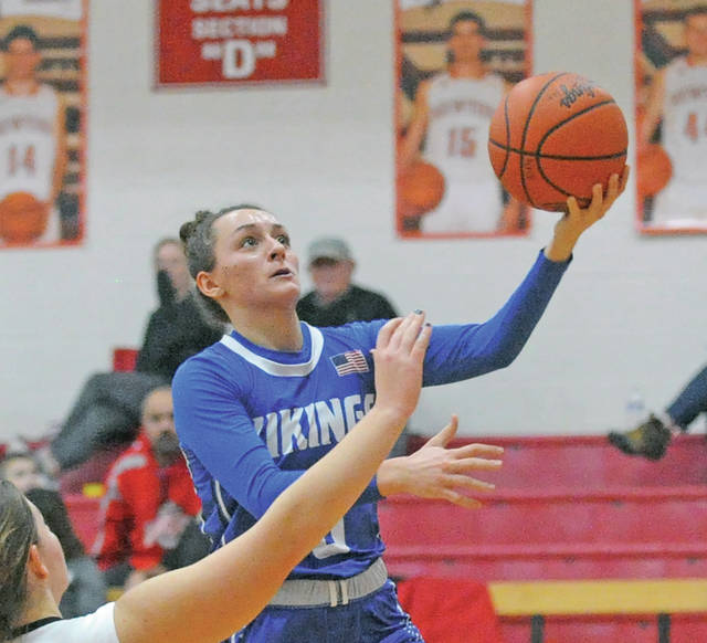 Josh Brown|Miami Valley Today Miami East's Morgan Haney lays the ball in after a Newton turnover Thursday at Newton High School.