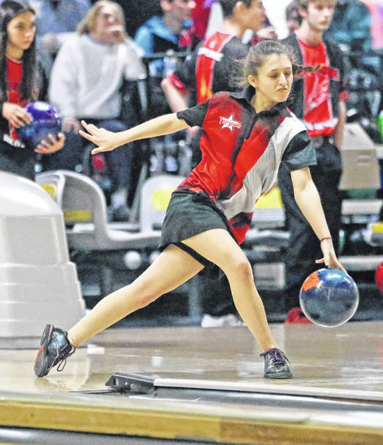 Lee Woolery|Miami Valley Today Troy's Cassie McMullen bowls against Tippecanoe Thursday at Troy Bowl.
