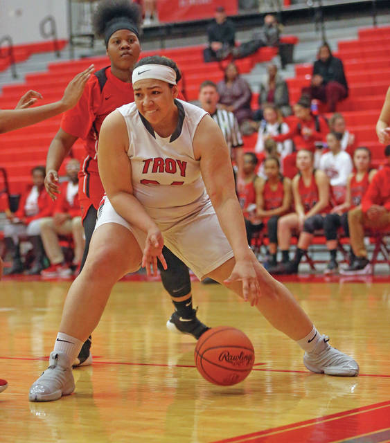 Lee Woolery Miami Valley Today Troy's Tia Bass works in the paint Friday night against West Carrollton during the first game of a girls-boys doubleheader at the Trojan Activities Center.