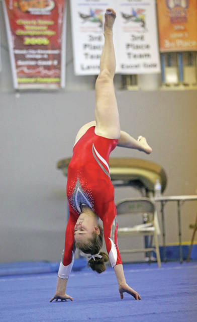 Lee Woolery | Miami Valley Today Troy's Lizzie Deal, shown here competing on the floor exercise, placed second in the all-around Monday at the Northmont Invitational.