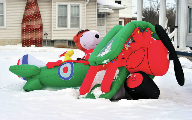 Mike Ullery | Daily Call You know that it is cold when Snoopy is grounded! The World War I flying ace and his Sopwith Camel wait for warmer weather in a yard on Riverside Drive in Piqua.