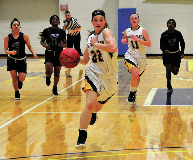 Edison State's Clair Schmitmeyer races down the floor on a fast break on Monday against Cincinnati Christian University.