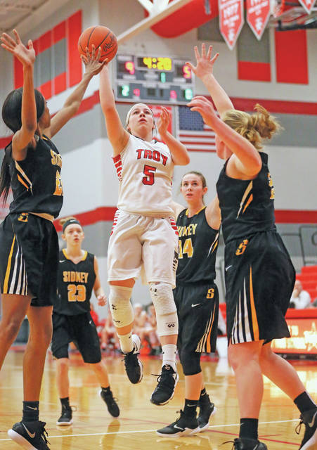 Lee Woolery|Miami Valley Today Troy's Macie Taylor drives to the basket in the middle of the Sidney defense Wednesday night at the Trojan Activities Center.