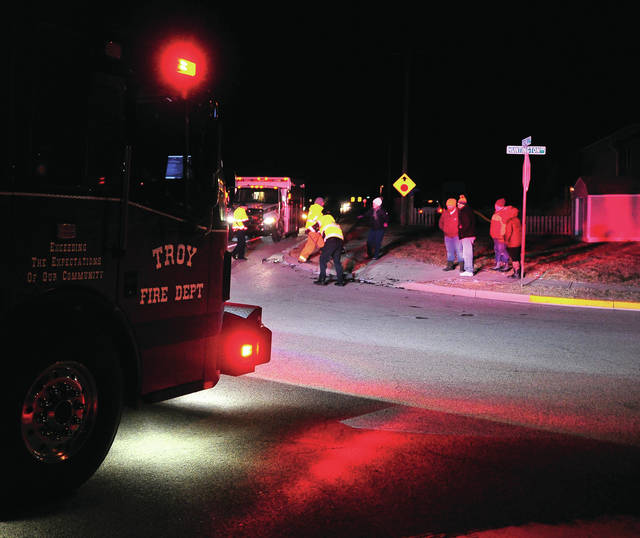 Troy Fire Department, medics, and police work the scene of a two-vehicle crash at the intersection of Nashville Road and Huntington Drive on Wednesday evening. One victime was transported to Upper Valley Medical Center for treatment.