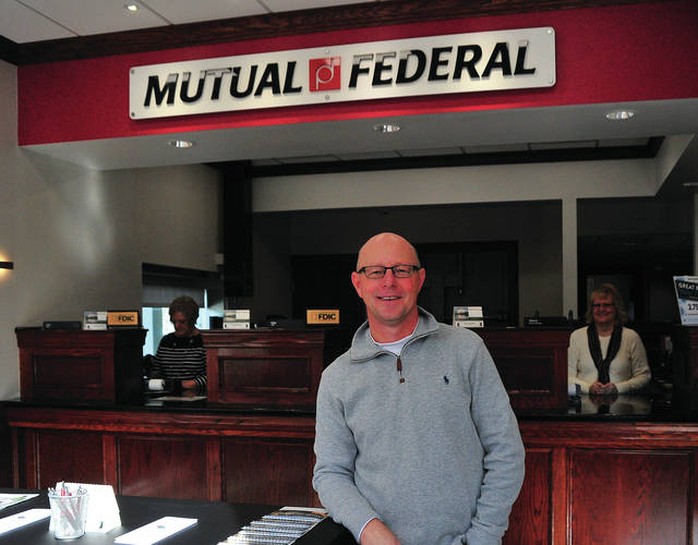 Brett Baumeister, Western Ohio Market President for Mutual Federal talks about the newly opened branch in downtown Piqua on Wednesday.