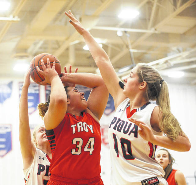 Lee Woolery|Miami Valley Today file Troy's Tia Bass goes up for a shot as Piqua's Aubree Schrubb (10) defends earlier this season at Piqua.
