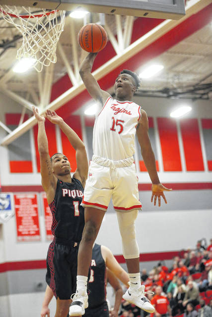 Lee Woolery|Miami Valley Sunday News file Troy's Caillou Monroe dunks during the Trojans' win over Piqua earlier this season. The Trojans have lost five straight since that game as the season reaches the halfway point.