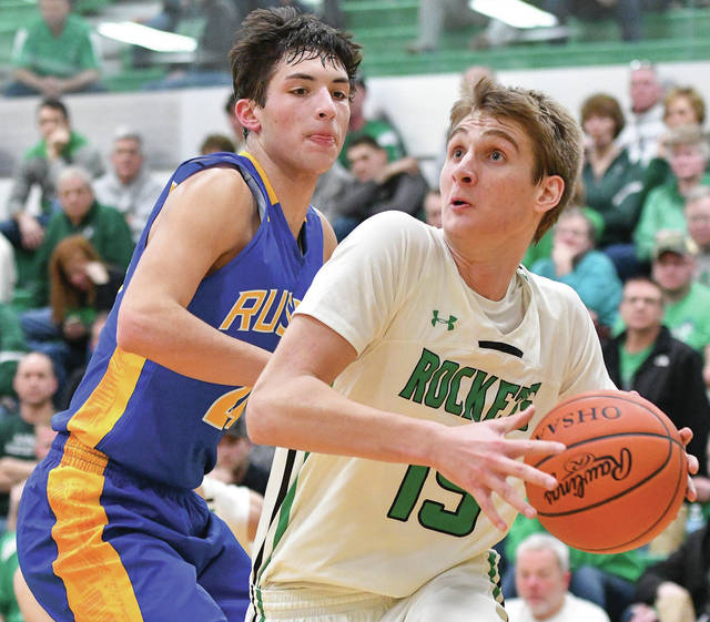 Bryant Billling|Aim Media Photo Anna senior Griffin Doseck, right, drives to the basket with pressure from Russia's Daniel Kearns Tuesday night.