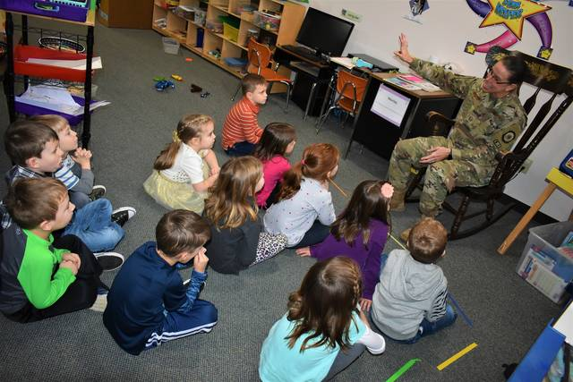 Cody Willoughby | Troy Daily News M. Sgt. Jennifer Godsey discusses her service in Kuwait with pre-schoolers on Monday at First Kids Christian Cooperative Preschool in Troy.
