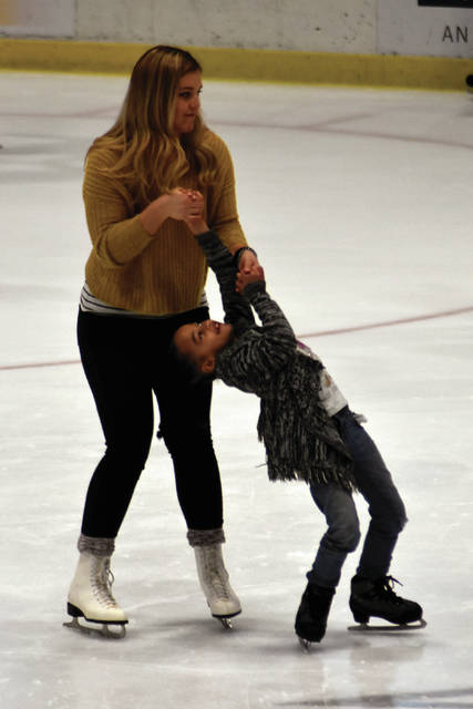 Cody Willoughby | Troy Daily News Olivia Young, of Casstown, helps Zara Supringer, 6, of Versailles, find her balance during public skating on Saturday at Hobart Arena. For information on hours and pricing, visit www.hobartarena.com.