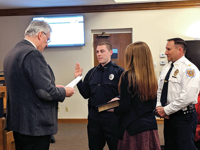 Cecilia Fox | Troy Daily News The city's newest officer, Adam Bernard, was sworn in Monday night.