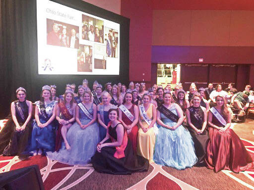 Provided by the Ohio Fair Managers Association The 2018 Miami County Fair Queen Kelci Cooper sits directly behind the 2018 Ohio Fairs' Queen Morgan McCutcheon, kneeling in front. Cooper, of Piqua, participated in the annual pageant on Thursday evening at the 94th annual Ohio Fair Managers Convention & Trade Show in Columbus. The pageant winner will be named Saturday during the convention.