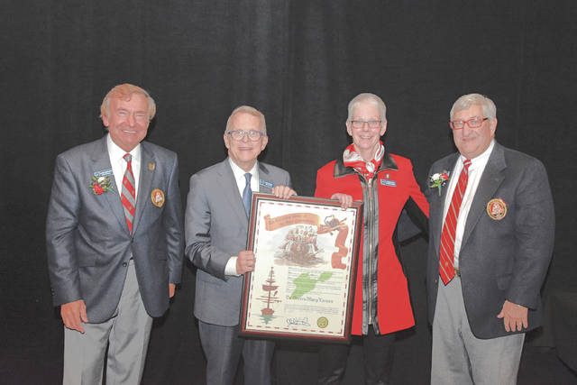 Provided photo Edison State Community College President Dr. Doreen Larson, second from right, stands with, left to right Grand Commodore Sam Covelli, Gov. Mike DeWine, and Past Grand Commodore Alan Stockmeister, at her induction into the Association of Ohio Commodores.
