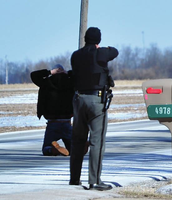 Miami County Sherff's deputies, prepare to take into custody a subject who was reported to be suicidal and led law enforcement on a chase on the west side of the county on Thursday afternoon. Miami County Sherff's deputies, prepare to take into custody a subject who lwas reported to be suicidal and led law enforcement on a chase on the west side of the county on Thursday afternoon.