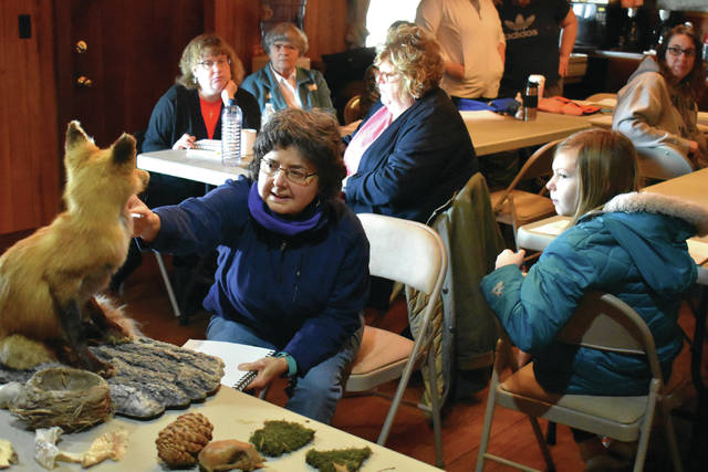 Cody Willoughby | Troy Daily News Park naturalist Kay Hisong leads park guests in a tutorial on nature sketching on Saturday at Lost Creek Reserve.
