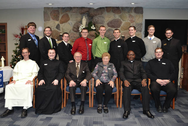 Provided photo Catholic seminarians and religious from the north deaneries of the Archdiocese of Cincinnati recently received scholarships from the Darke County Foundation. Front row: Br. Bernard Knapke, St. Henry; Patrick Blenman, Sidney; Melvin and Mary Ann Stucke, Versailles (donors); Deacon Elias Mwesigye, Botkins; Deacon Zach Cecil, Piqua. Back row: Greg Evers, St. Rose; Lee Rosenbeck, Russia; Zacharias Schoen, Celina; Kraig Gruss, Coldwater; Brice Berger, Yorkshire; Loren Hein, Celina; Ethan Hoying, Russia; Max Travis, New Bremen; Aaron Hess, Philothea. Not pictured: Sister Mary Xavier Schulze, McCartyville; Sister Monica Marie Slonkosky, Minster; Elijah Puthoff, Russia; David Slonkosky, Minster; James Walters, Sidney.