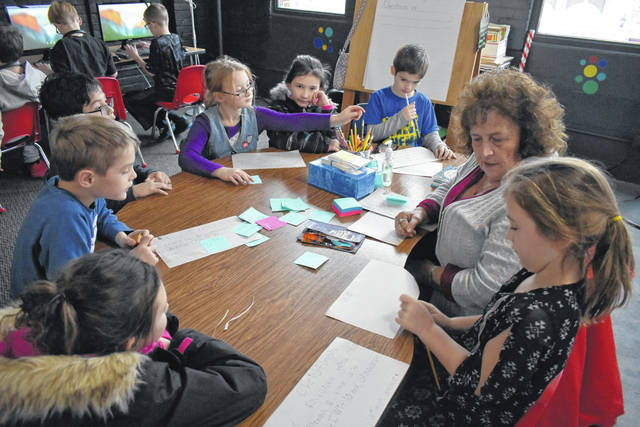 Cody Willoughby | Troy Daily News Volunteer Sandy Lutz tutors children during a regular session at Reading for Change on Wednesday in Troy.