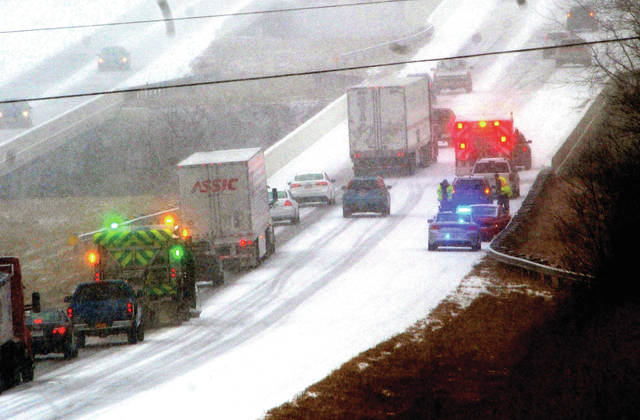 As snow began to fall across Miami County on Sunday, a number of crashes occurred on I-75 causing backups and the eventual closure of the highway as emergency crews worked to clear many crashes and slide-offs.